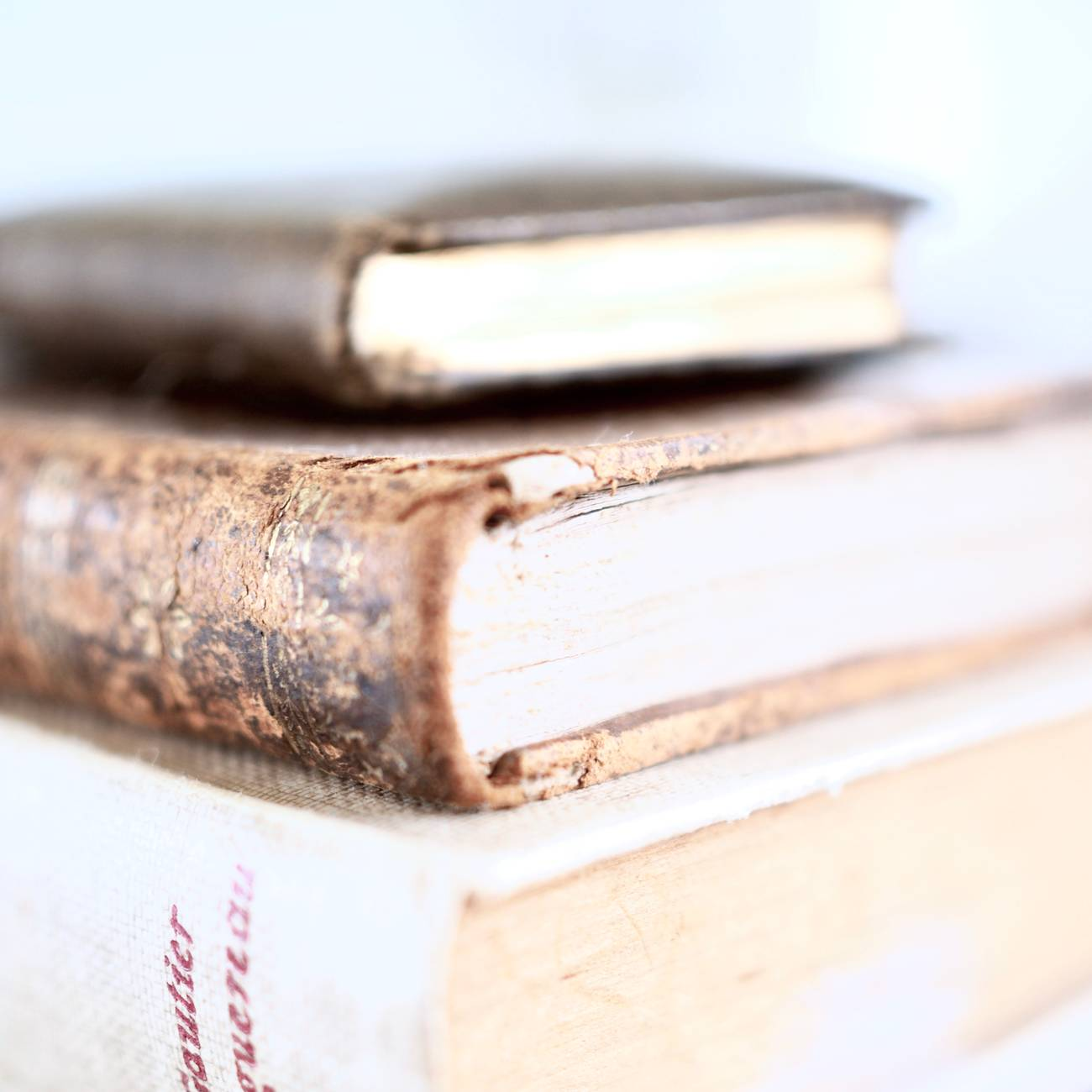 stack of thick books on table